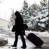 A person walks in a snowfall at Buffalo Niagara International Airport in Buffalo, N.Y., Saturday, Dec. 29, 2012. A mild but widespread winter storm has developed over the Northeast and the upper Ohio River Valley, the second in less than a week for the regions. (AP Photo/Mel Evans)