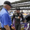 Photo - NASCAR team owner Joe Gibbs, left, talks with Denny Hamlin before the Brickyard 400 auto race at Indianapolis Motor Speedway in Indianapolis, Sunday, July 27, 2014. (AP Photo/Darron Cummings)