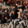 Oklahoma State\'s Levy Adcock (73) celebrates a defensive stop late in the fourth quarter during a college football game between the Oklahoma State University Cowboys (OSU) and the Kansas State University Wildcats (KSU) at Boone Pickens Stadium in Stillwater, Okla., Saturday, Nov. 5, 2011. Photo by Sarah Phipps, The Oklahoman