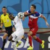 Ghana\'s Kwadwo Asamoah, left, pushes off United States\' Alejandro Bedoya during the group G World Cup soccer match between Ghana and the United States at the Arena das Dunas in Natal, Brazil, Monday, June 16, 2014. (AP Photo/Petr David Josek)