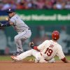 Photo - St. Louis Cardinals' Jon Jay (19) is forced out at second by San Diego Padres' Alexi Amarista, left, during the second inning in a baseball game, Saturday, Aug. 16, 2014, at Busch Stadium in St. Louis. Shelby Miller was safe at first. (AP Photo/Bill Boyce)