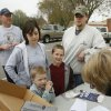 Alissa Rigsby (left), Cole Lakin, 5, Brayden Wernli, 8, and David Wernli pick up trash bags at the city administration building in Edmond, OK, as part of a city effort to clean up the streets, Saturday, April 18, 2009. BY PAUL HELLSTERN, THE OKLAHOMAN