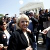 Arizona Gov. Jan Brewer is followed by reporters outside the Supreme Court in Washington, Wednesday, April 25, 2012, after the court\'s hearing on Arizona\'s