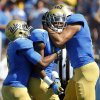 UCLA running back Jordon James, left, and tight end Joseph Fauria, right, celebrate wide receiver Shaquelle Evans\' 64-yard touchdown run after a catch against Utah during the first half of their NCAA college football game, Saturday, Oct. 13, 2012, in Pasadena, Calif. (AP Photo/Alex Gallardo)