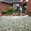 Sandra and George Poplin look at the front yard of their Midwest City home after a severe hail storm hit areas of eastern Oklahoma County, including these homes in the Windsong neighborhood, near SE 15 and Westminster, late Sunday afternoon, May 16, 2010. Photo by Jim Beckel, The Oklahoman