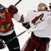 Phoenix Coyotes\' Rob Klinkhammer, right, is hit by Chicago Blackhawks\' Bryan Bickell during the third period of an NHL hockey game in Chicago, Thursday, Nov. 14, 2013. The Blackhawks won 5-4. (AP Photo/Nam Y. Huh)