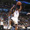 Oklahoma City\'s Russell Westbrook (0) shoots as Memphis\' Tony Allen (9) and Mike Conley (11) defend during the NBA basketball game between the Oklahoma City Thunder and the Memphis Grizzlies, Saturday, Jan. 8, 2011, at the Oklahoma City Arena. Photo by Sarah Phipps, The Oklahoman