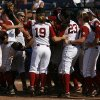 Alabama celebrates a win against California during a Women\'s College World Series game at ASA Hall of Fame Stadium in Oklahoma City, Sunday, June 3, 2012. Photo by Garett Fisbeck, The Oklahoman