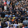 Turkey\'s Prime Minister Recep Tayyip Erdogan, center right, is surrounded by security members as he visits the coal mine in Soma, Turkey, Wednesday, May 14, 2014. An explosion and fire at the coal mine killed at least 232 workers, authorities said, in one of the worst mining disasters in Turkish history. Turkey\'s Energy Minister Taner Yildiz said 787 people were inside the coal mine at the time of the accident. (AP Photo/Emre Tazegul)
