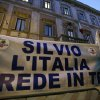 Supporters of former Italian premier Silvio Berlusconi expose a banner reading