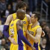 Photo - Los Angeles Lakers' Steve Nash, right, Kobe Bryant (24) and Pau Gasol, of Spain, talk during a timeout against the Phoenix Suns during the second half of an NBA basketball game, Wednesday, Jan. 30, 2013, in Phoenix. The Suns won 92-86. (AP Photo/Matt York)