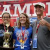 Photo - Melanie Kohout, center, of Geneva, Ill., Rally Masters winner, poses with her parents, Grace and Stan Inglehart, during the 76th All-American Soap Box Derby on Saturday, July 27, 2013, in Akron, Ohio. (AP Photo/Akron Beacon Journal, Paul Tople)