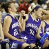 Okarche\'s Madison Lee (24) and Kenadey Grellner (22) celebrate on the bench in the final minutes of a Class A Girls semifinal game of the state high school basketball tournament between Okarche and Turner at Jim Norick Arena, The Big House, on State Fair Park in Oklahoma City, Friday, March 1, 2013.Okarche won, 62-24. Photo by Nate Billings, The Oklahoman