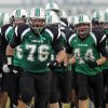 The Bishop McGuinness Fighting Irish take the field before a 2011 game against Millwood. Photo by Nate Billings, The Oklahoman Archives
