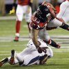 Photo -   Atlanta Falcons running back Michael Turner (33) is hit by Denver Broncos free safety Rahim Moore (26) during the first half of an NFL football game, Monday, Sept. 17, 2012, in Atlanta. (AP Photo/John Bazemore)