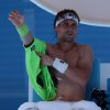 Photo - David Ferrer of Spain changes his shirt   during his third round match against  Jeremy Chardy of France at the Australian Open tennis championship in Melbourne, Australia, Friday, Jan. 17, 2014.(AP Photo/Aaron Favila)