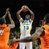 Photo - OSU: Baylor's Ekpe Udoh (13) shoots between Oklahoma State University's Matt Pilgrim, left, and Obi Muonelo, right, during the first half of an NCAA college basketball game, Saturday,  Jan. 16, 2010, in Waco Texas.  Baylor  won  83-70. (AP Photo/Rod Aydelotte) ORG XMIT: TXRA105