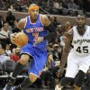 New York Knicks\' Carmelo Anthony, left, drives around San Antonio Spurs\' DeJuan Blair during the first half of an NBA basketball game on Thursday, Nov. 15, 2012, in San Antonio. (AP Photo/Darren Abate)