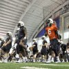 Photo - In this photo taken on Tuesday, March 18, 2014, Auburn quarterbacks Jeremy Johnson (6) and Nick Marshall (14) stretch during Auburn's first spring NCAA college football practice at the Auburn Athletic Complex in Auburn, Ala. (AP PHOTO/AL.com, Julie Bennett) MAGS OUT