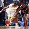 Photo - Tennessee forward Jasmine Jones (2) and South Carolina center Elem Ibiam (33) battle for a loose ball in the first half of an NCAA college basketball game on Sunday, March 2, 2014, in Knoxville, Tenn. (AP Photo/Wade Payne)