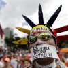 An opponent of Venezuela\'s President Hugo Chavez wears a message over his mouth that reads in Spanish;