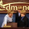 Edmond Mayor Patrice Douglas and her sons Patrick, 14, and Phillip, 11, (right) look at her new chair at the council chambers during a ceremony at Edmond\'s Council Chambers in Edmond on Monday, May 4, 2009. Photo by John Clanton, The Oklahoman