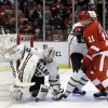Photo - Dallas Stars goalie Kari Lehtonen (32), of Finland, stops a shot as Detroit Red Wings wing Daniel Cleary (11) waits for the rebound next to Dallas Stars defenseman Jordie Benn (58) during the second period of an NHL hockey game in Detroit, Tuesday, Jan. 29, 2013. (AP Photo/Paul Sancya)