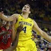 Michigan forward Mitch McGary (4) waits for the rebound during the second half of an NCAA college basketball game against Arizona in Ann Arbor, Mich., Saturday, Dec. 14, 2013. (AP Photo/Carlos Osorio)