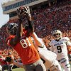 OSU\'s Justin Blackmon (81) makes a touchdown catch in the second quarter despite the defense of Baylor\'s K.J. Morton (8) near Chance Casey (9) during a college football game between the Oklahoma State University Cowboys (OSU) and the Baylor University Bears (BU) at Boone Pickens Stadium in Stillwater, Okla., Saturday, Oct. 29, 2011. Photo by Nate Billings, The Oklahoman
