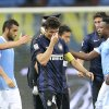 Photo - Inter Milan's Javier Zanetti,of Argentina, center, wipes his eyes at the end of the Serie A soccer match between Inter Milan and Lazio at the San Siro stadium in Milan, Italy, Saturday, May 10, 2014. Zanetti will retire after 19 seasons at Inter, and the stadium was sold out as fans packed in to bid farewell to their 40-year-old captain. (AP Photo/Antonio Calanni)