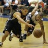 Charlotte Bobcats\' Denis Clemente, left, and Oklahoma City Thunder\'s Eric Maynor go after a loose ball during the second half of an NBA summer league basketball game in Orlando, Fla., Tuesday, July 6, 2010.(AP Photo/John Raoux) ORG XMIT: FLJR117