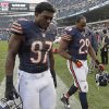 Chicago Bears linebacker J.T. Thomas (97) and running back Michael Bush (29) leave the field after the Bears\' 23-17 loss in overtime to the Seattle Seahawks overtime in an NFL football game in Chicago, Sunday, Dec. 2, 2012. (AP Photo/Nam Y. Huh)