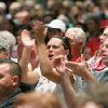 Photo - Attendees cheer as Riverside County Supervisor Jeff Stone speaks during a meeting about a plan to process immigrants detained in Texas at the Murrieta U.S. Border Patrol facility, during a meeting at the Murrieta Mesa High School auditorium Wednesday, July 2, 2014, in Murrieta, Calif. (AP Photo/The Press-Enterprise, Terry Pierson)