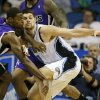 Sacramento Kings\' Tyreke Evans (13) tries for a steal as Orlando Magic\'s Nikola Vucevic, of Montenegro, works to keep control of the ball during the first half of an NBA basketball game, Wednesday, Feb. 27, 2013, in Orlando, Fla. (AP Photo/John Raoux)