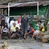 Residents wait for relief supplies at the flash flood-hit village of Andap, New Bataan township, Compostela Valley in southern Philippines Wednesday, Dec. 5, 2012, a day after the devastating Typhoon Bopha made a landfall. Typhoon Bopha, one of the strongest typhoons to hit the Philippines this year, barreled across the country\'s south on Tuesday, killing scores of people and forcing more than 50,000 to flee from inundated villages. (AP Photo/Bullit Marquez)