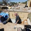 Gerald Newby walks down into the storm cellar at the home of his mother, Debbie Whisennand, and stepfather, Tom Whisennand, to collect valuables that have been stored in the cellar while cleaning up what is left of the home in Woodward, Okla., Monday, April 16, 2012. The Whisennands took shelter in the storm cellar as a tornado struck the town early Sunday morning. Photo by Nate Billings, The Oklahoman