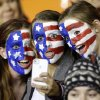United States fans take their own picture with a mobile device before an exhibition soccer match against China, Wednesday, Dec. 12, 2012, in Houston. (AP Photo/David J. Phillip)