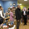 Photo -   President Barack Obama, with daughters Sasha, left, and Malia, center, goes shopping at a small bookstore, One More Page, in Arlington, Va., Saturday, Nov. 24, 2012. (AP Photo/J. Scott Applewhite)