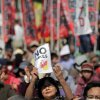 Photo - A protester holds aloft an anti-nuclear power plant sign as they stage a rally at a park in Tokyo, Saturday, March 9, 2013. Thousands of people rallied in a Tokyo park Saturday, demanding an end to atomic power, and vowing never to give up the fight, despite two years of little change after the nuclear disaster in Fukushima, northeastern Japan. (AP Photo/Itsuo Inouye)