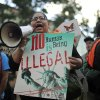 Esmeralda Dominguez demonstrates against the deportation of Illegal immigrants, during a protest at the University of Denver, site of the presidential debate, Wednesday, Oct. 3, 2012, in Denver. (AP Photo/The Denver Post, Hyoung Chang) MAGS OUT TV OUT ONLINES OUT ORG XMIT: CODEN501