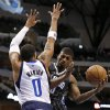 Dallas Mavericks\' Shawn Marion (0) defends as Orlando Magic\'s DeQuan Jones (20) looks for a shot during the first half of an NBA basketball game Wednesday, Feb. 20, 2013, in Dallas. (AP Photo/Tony Gutierrez)