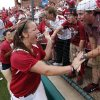 Pitcher Keilani Ricketts celebrates with fans at the NCAA Super Regional softball game as the University of Oklahoma (OU) Sooners defeat Texas A&M 8-0 at Marita Hines Field on Saturday, May 25, 2013 in Norman, Okla. to advance to the College World Series. Photo by Steve Sisney, The Oklahoman