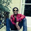 This undated photo of Lenny Kravitz is provided by Toms shoe brand. Kravitz is the company\'s guest designer for its 2012 spring-summer collection, which includes a pair decorated with lyrics from his song
