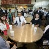 President Barack Obama sits down to have lunch at a Chipotle Mexican Grill in Washington, Monday, June 23, 2014, before they attending the White House Summit on Working Families. Sitting with Obama are from left are, Rodger Trombley, Lisa Rumain, Shelby Ramirez and Shirley Young. Obama is encouraging more employers to adopt family-friendly policies, part of a broader effort to convince employers that providing more flexibility is good for business as well as workers. (AP Photo/Pablo Martinez Monsivais)