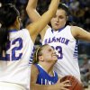 Lomega\'s Ashley LaGasse (22) tries to drive between Hammon\'s Peyton Walker (23) and Jamie Highwalker (22) during a Class B Girls semifinal game of the state high school basketball tournament between Hammon and Lomega at Jim Norick Arena, The Big House, on State Fair Park in Oklahoma City, Friday, March 1, 2013. Photo by Nate Billings, The Oklahoman