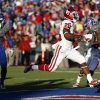 OU\'s Damien Williams (26) scores a touchdown in the fourth quarter during of the college football game between the University of Oklahoma Sooners (OU) and the University of Kansas Jayhawks (KU) at Memorial Stadium in Lawrence, Kan., Saturday, Oct. 19, 2013. OU won 34-19. Photo by Sarah Phipps, The Oklahoman