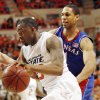 OSU\'s James Anderson (23) drives past Xavier Henry (1) of KU in the first half during the men\'s college basketball game between the University of Kansas (KU) and Oklahoma State University (OSU) at Gallagher-Iba Arena in Stillwater, Okla., Saturday, Feb. 27, 2010. Photo by Nate Billings, The Oklahoman