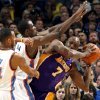 Oklahoma City\'s Daequan Cook (14) and Serge Ibaka (9) pressure Lakers\' Lamar Odom (7) during the NBA basketball game between the Oklahoma City Thunder and the Los Angeles Lakers, Sunday, Feb. 27, 2011, at the Oklahoma City Arena.Photo by Sarah Phipps, The Oklahoman