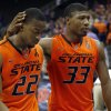 Oklahoma State\'s Marcus Smart (33) consoles Markel Brown (22) as they walk off the court following the Phillips 66 Big 12 Men\'s basketball championship tournament game between Oklahoma State University and Kansas State at the Sprint Center in Kansas City, Friday, March 15, 2013. Photo by Sarah Phipps, The Oklahoman