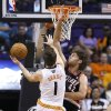 Photo - Phoenix Suns' Goran Dragic (1), of Slovenia, gets a shot off over Portland Trail Blazers' Robin Lopez (42) during the first half in an NBA basketball game Wednesday, Oct. 30, 2013, in Phoenix. (AP Photo/Ross D. Franklin)
